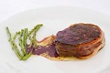 foal fillet with bacon in Teran wine sauce and wild asparagus